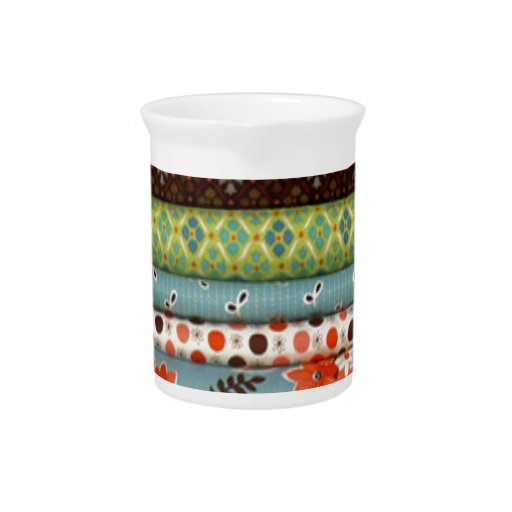 Bolts of fabric, pretty cotton designs beverage pitchers