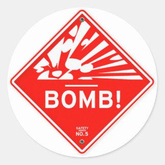 Bomba de la seguridad que advierte la precaución pegatina redonda