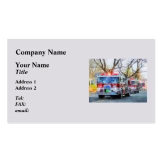 Bomberos - línea de coches de bomberos en desfile tarjetas de negocios