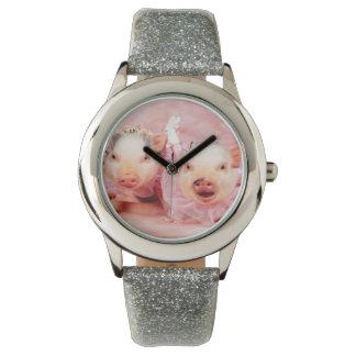 Bonito en reloj rosado del brillo de los niños de