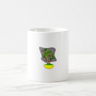 Bonsais del jade en pote amarillo taza básica blanca