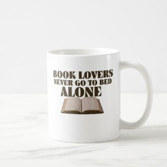 Book lovers never go to bed alone coffee mug