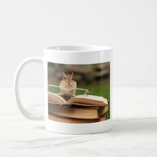 Book loving chipmunk coffee mug