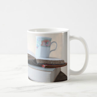 Book stack with cup