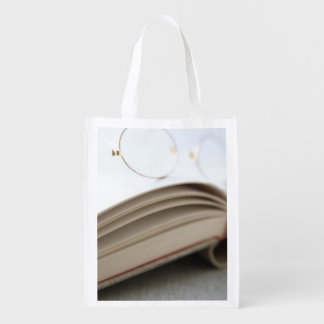 Book with glasses grocery bags