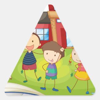 Books and children at the school triangle sticker