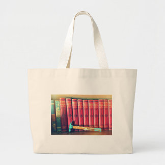 Books are stronger than hammers large tote bag