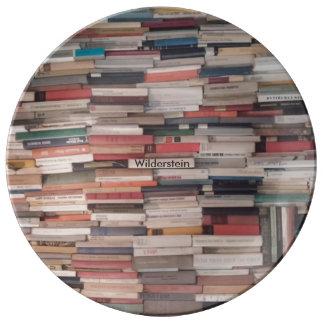 Books Piled Up With Custom Name Like Title Plate