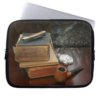 Books, Pipe, Pocket Watch and Knife on Table Laptop Sleeve