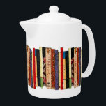 """Books Teapot<br><div class=""""desc"""">This brilliantly colored white porcelain teapot features a shelf of colorful books. They form an interesting abstract vertical geometrical pattern in colors of green,  brown,  yellow,  red,  blue,  black and pink.</div>"""