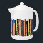 "Books Teapot<br><div class=""desc"">This brilliantly colored white porcelain teapot features a shelf of colorful books. They form an interesting abstract vertical geometrical pattern in colors of green,  brown,  yellow,  red,  blue,  black and pink.</div>"