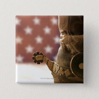 Boot and spur pinback button
