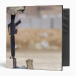Boots, rifle, dog tags, and protective helmet 3 ring binder