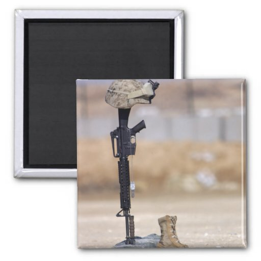 Boots, rifle, dog tags, and protective helmet magnet
