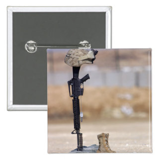 Boots, rifle, dog tags, and protective helmet pinback button