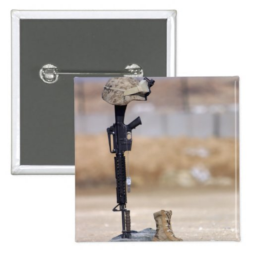 Boots, rifle, dog tags, and protective helmet pins