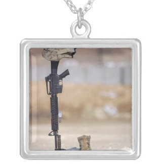 Boots, rifle, dog tags, and protective helmet square pendant necklace