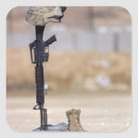 Boots, rifle, dog tags, and protective helmet square sticker