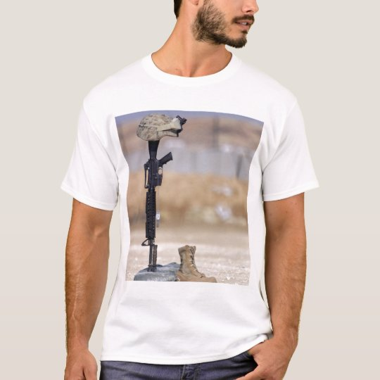 Boots, rifle, dog tags, and protective helmet T-Shirt