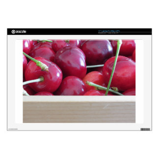 Border of fresh cherries on wooden background decal for laptop