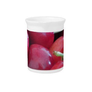 Border of fresh cherries on wooden background drink pitchers
