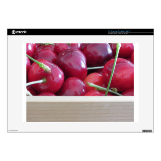 Border of fresh cherries on wooden background laptop decal