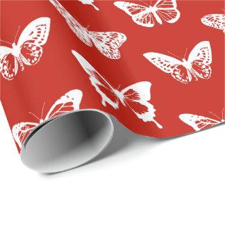 Bosquejo de la mariposa, de color rojo oscuro y papel de regalo