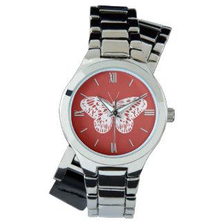 Bosquejo de la mariposa, de color rojo oscuro y reloj
