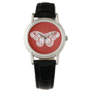 Bosquejo de la mariposa, de color rojo oscuro y reloj de mano