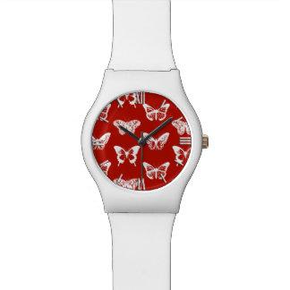 Bosquejo de la mariposa, de color rojo oscuro y relojes de pulsera