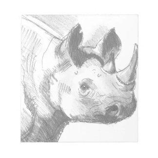 Bosquejo del dibujo de lápiz del rinoceronte del r blocs de notas