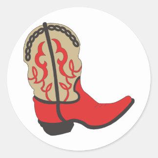 Bota de vaquero roja etiqueta redonda
