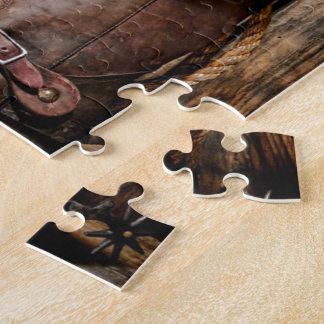 Botas de montar a caballo y gorra de vaquero puzzle