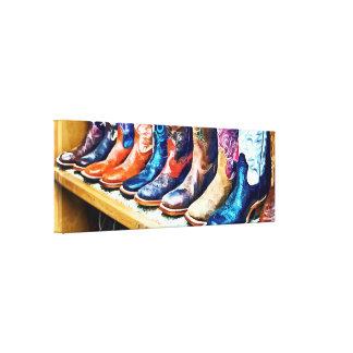 Botas de vaquero impresiones en lienzo estiradas