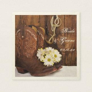 Botas de vaquero, margaritas y boda del pedazo del servilletas de papel