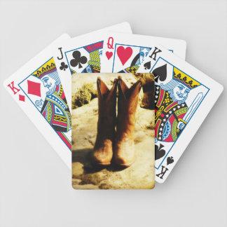 Botas de vaquero occidentales del país rústico en  cartas de juego