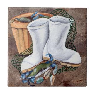 Botas y cangrejos blancos azulejos