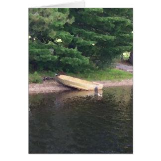 Bote de remos en la orilla tarjeta