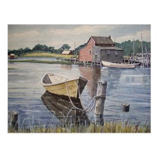Bote de remos en la postal del lago