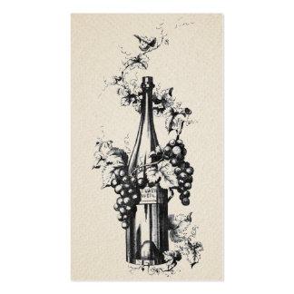 Botella 1873 de vino del vintage con las uvas y la tarjetas de visita