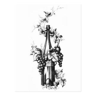Botella 1873 de vino del vintage con las uvas y la postal