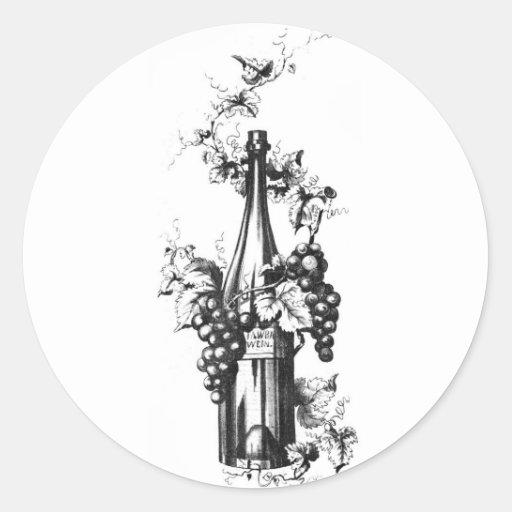 Botella 1873 de vino del vintage con las uvas y pegatina redonda