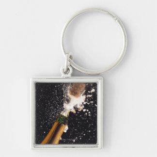 Botella de estallido del champán llavero cuadrado plateado
