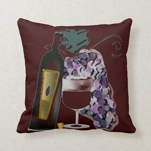Botella de uvas del vino n almohadas