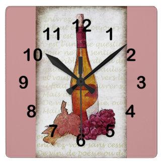 botella de vino, uvas y hoja de la uva reloj cuadrado