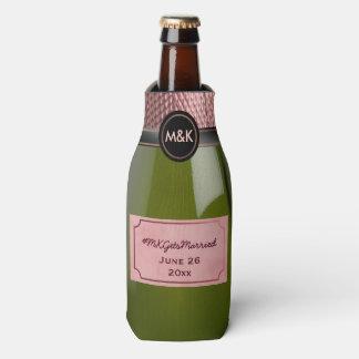Botella rosada de Rosé Champán que casa el Enfriador De Botellas