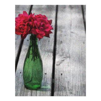 botella verde de los rosas rojos membrete