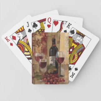 Botella y copas de vino de vino barajas de cartas