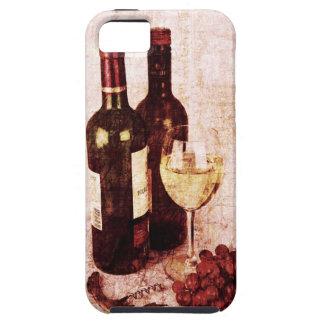 Botellas con el vino, la copa de vino blanca y las iPhone 5 carcasa
