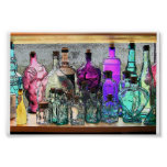 Botellas de cristal en ventana posters